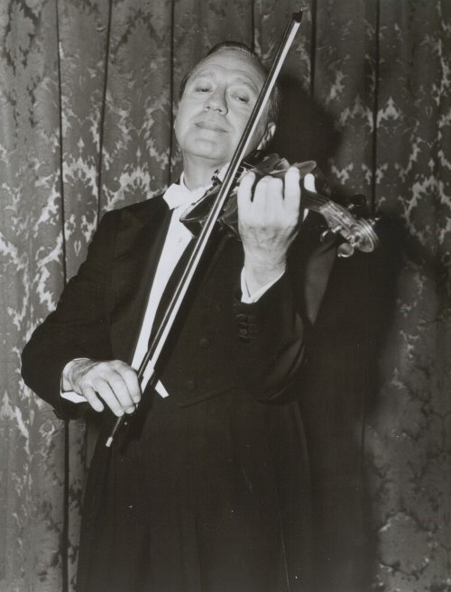 Jack Benny plays the violin