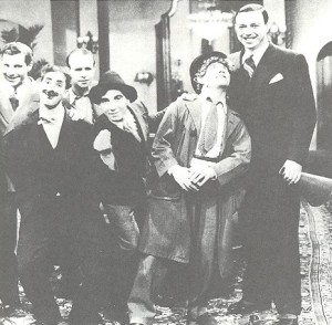 The Marxes with Florey and cinematagrapher George Folsey. Harpo stole the belt from Folsey's trousers