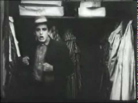 A pre-glasses Harold Lloyd hides in the closet
