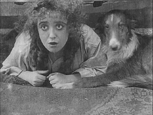 "Mabel Normand hides under the bed, ""Mabel's Strange Predicament"", 1914"