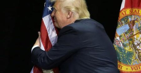 A fool and an ass in the act of desecrating the flag.