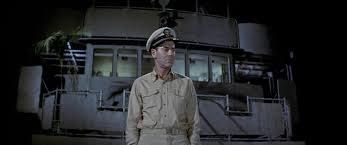 "The bridge on the ""Brown"" is not nearly as luxurious as the one we see beyong Mr. Roberts (Henry Fonda) on this navy cargo ship"