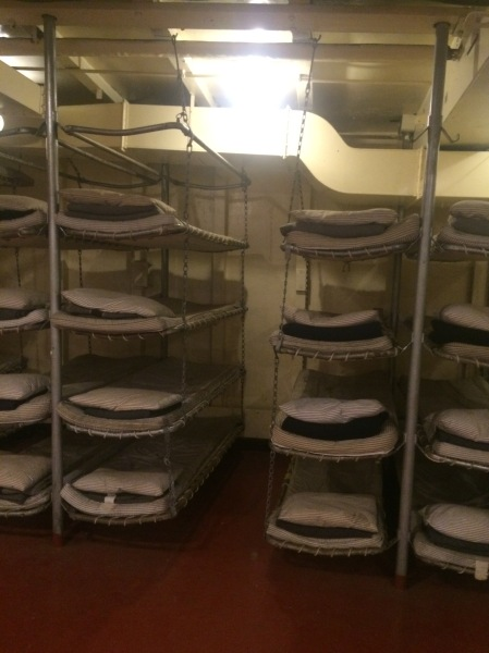 Troop bunks, stacked five high.