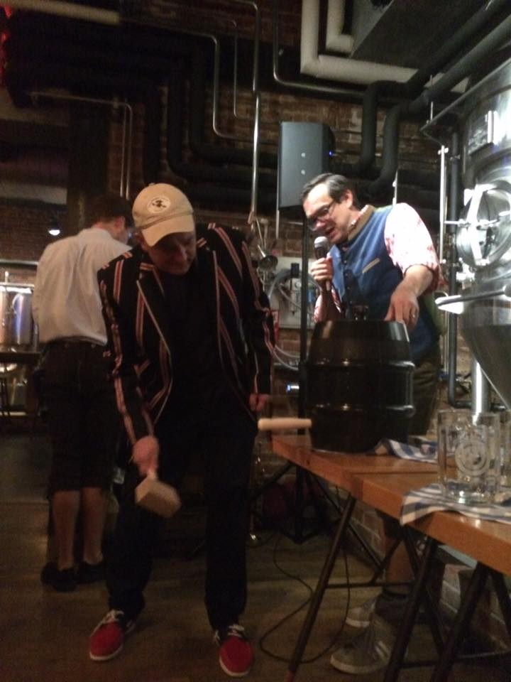 Groom ceremonially taps keg