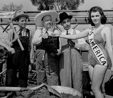 Jack Benny, W.C. Fields, Eddie Cantor in p.r. shot with Miss America, 1939